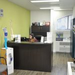 View of reception area with Twila working at the desk