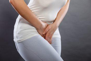 Woman holding a sore bladder